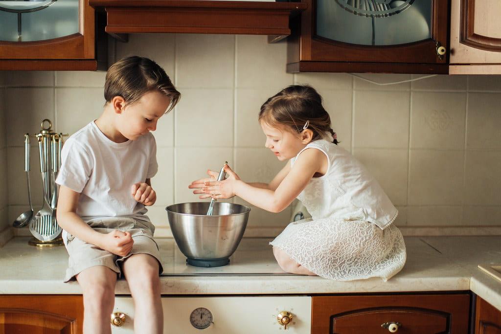 Children baking school cake together.