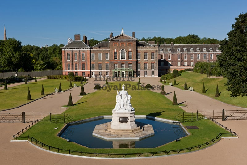 The East Front of Kensington Palace with statue and small pool.