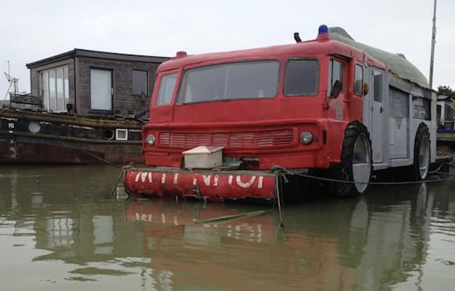 Quirky fire engine and upside-down boat at The Dodge Fire Engine Boat.