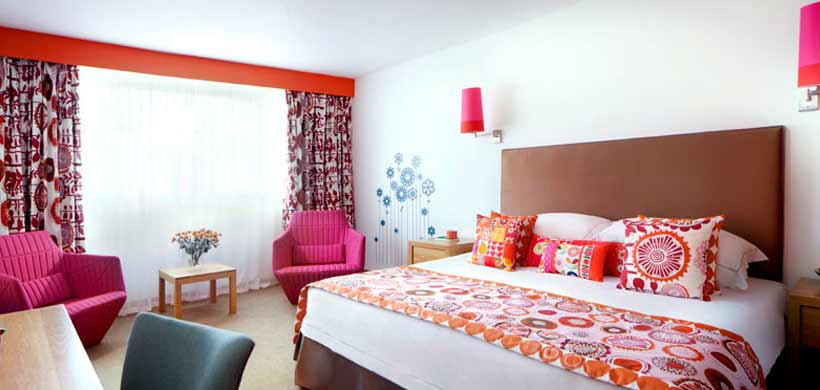 Colourful bedroom decor at family-friendly Bedruthan Hotel and Spa.