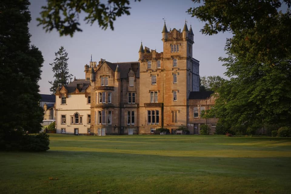 Grand facade of Cameron House, set in the Scottish countryside.