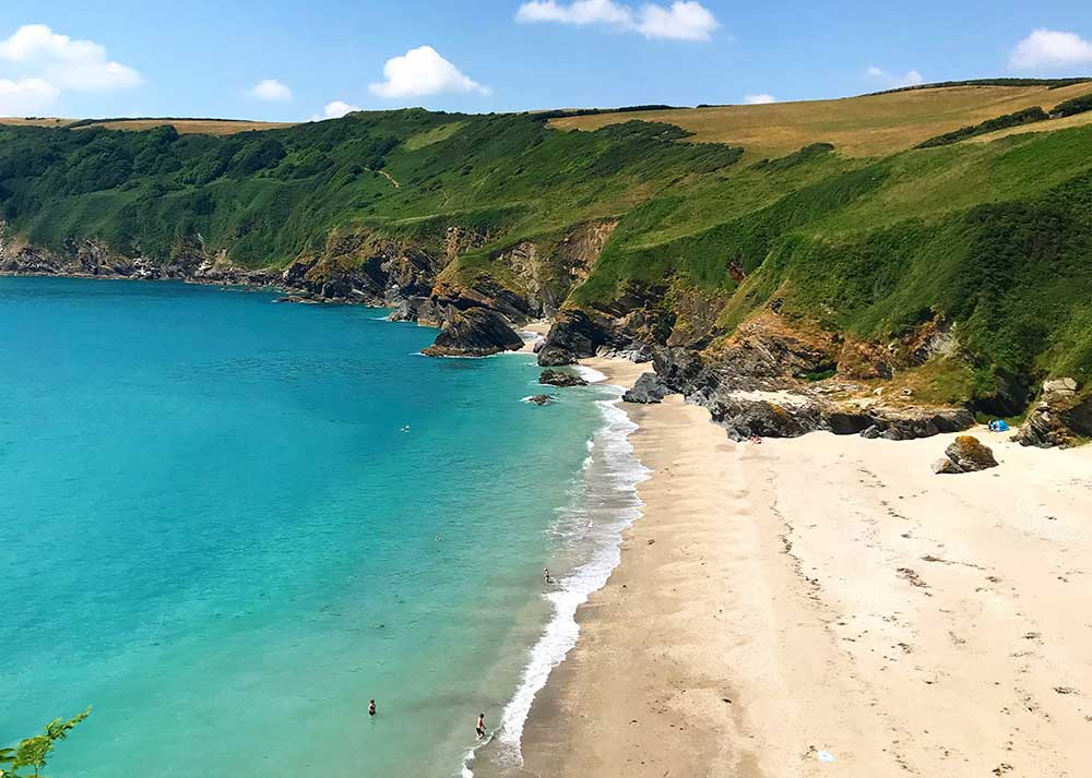 A beach in Cornwall on a sunny day.