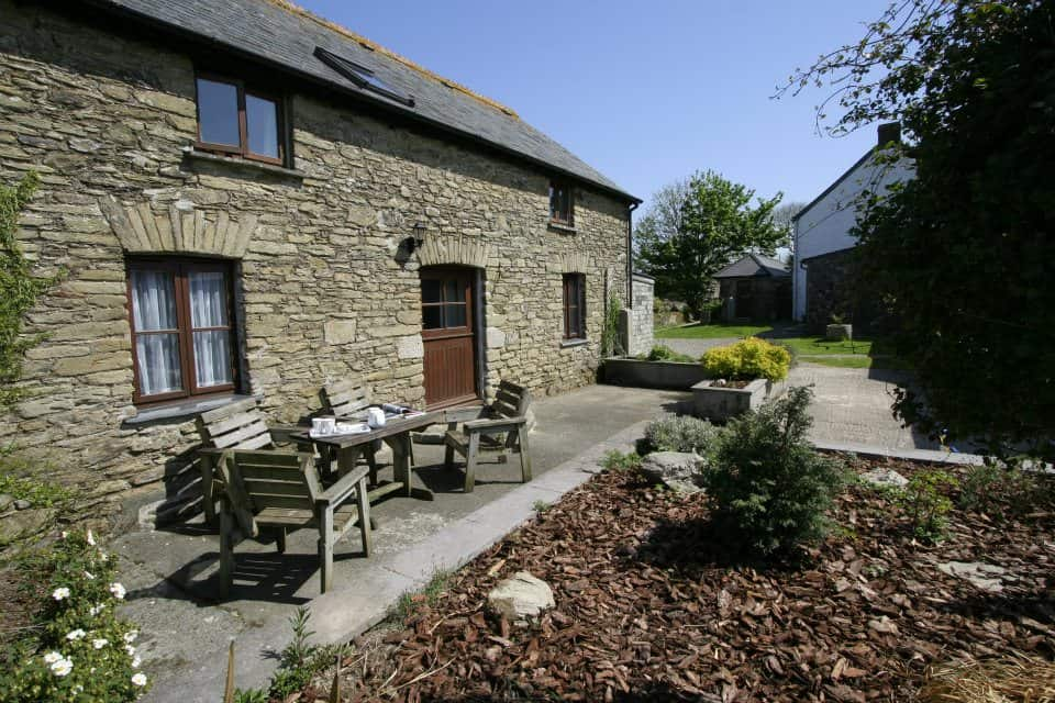 Outdoor seating area of Polean Farm Cottages, Cornwall.
