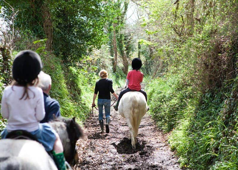 Kids going horse-riding during stay at Bosinver in Cornwall.