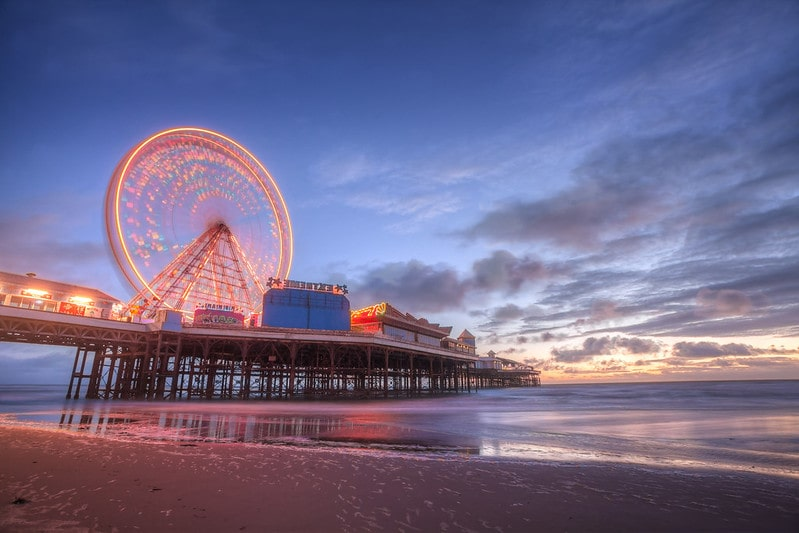 Blackpool pier lit up at sunset.
