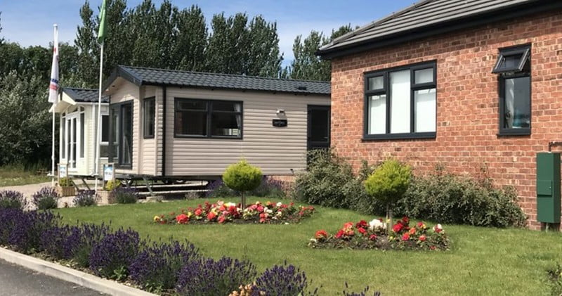 Pretty family lodges with front garden at Piper's Height Caravan Park, Blackpool.