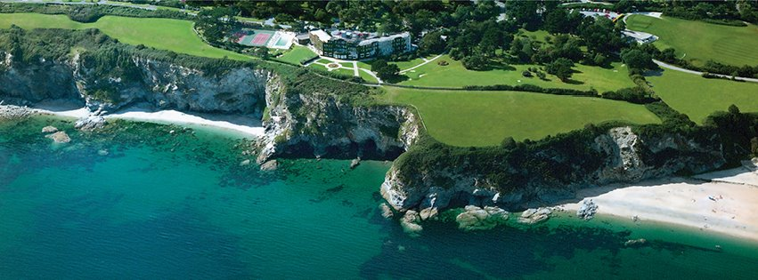 View from above of the luxury Carlyon Bay Hotel on cliff edge overooking the sea, Cornwall.