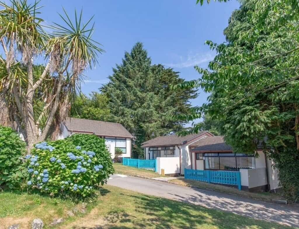 Peaceful bungalows at Seaview Holiday Village surrounded by trees.