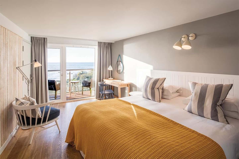 Luxury nautical-themed bedroom overlooking the Cornwall beach.