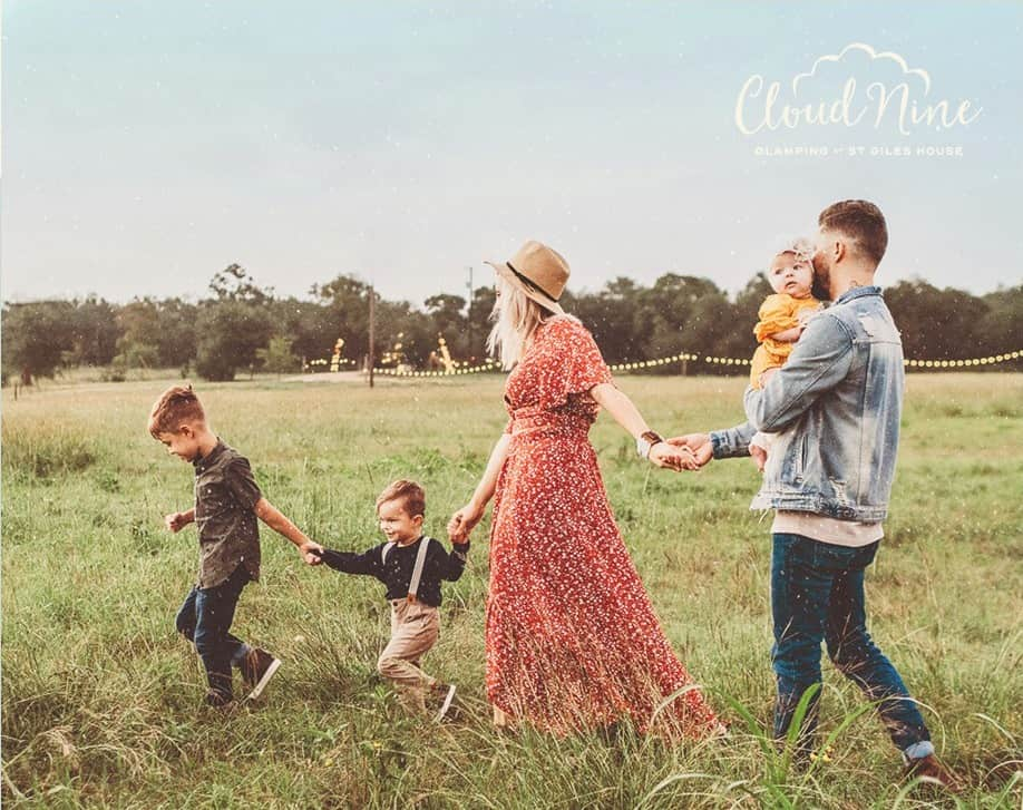 Family walking through the fields at Cloud Nine Glamping, Dorset.