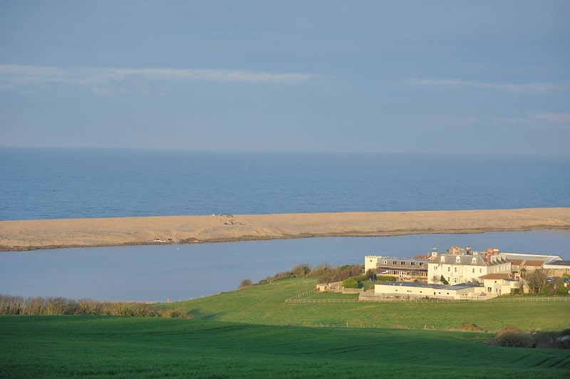 View of the sea from Moonfleet Manor set right by the water in Dorset.
