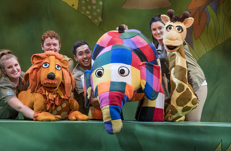 Large puppet show of Elmer the elephant and other characters from the book.
