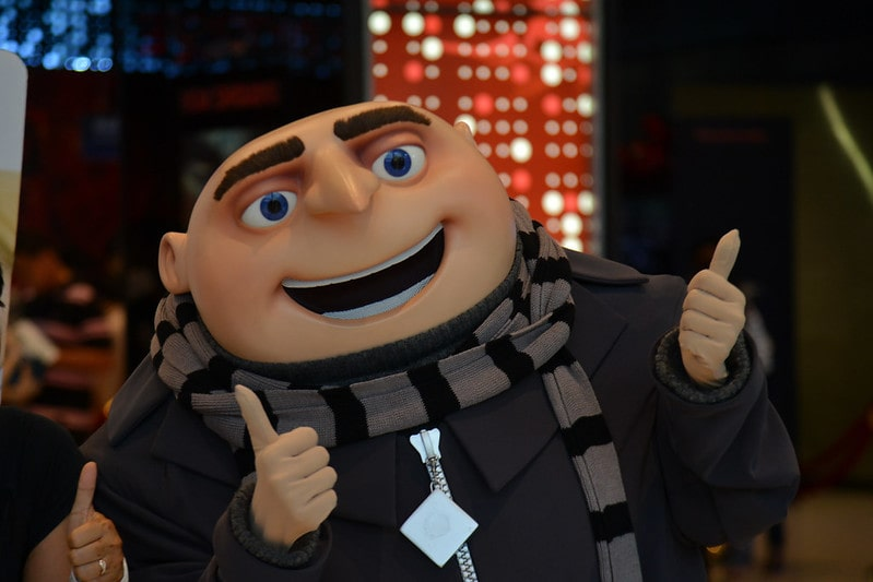 Gru from Despicable Me smiling and giving a thumbs up.