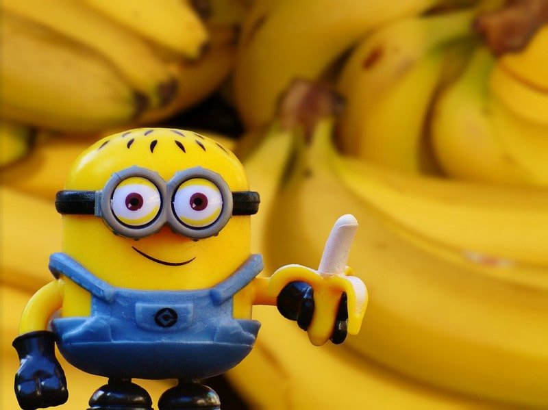 Minion holding out a peeled banana.