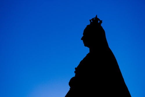 Silhouette of Queen Victoria against a blue background.