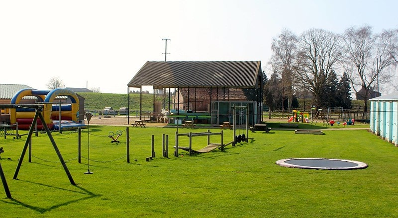 Outdoor play area for children at Tattershall Park Farm.