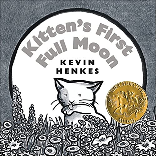 Front cover of Kitten's First Full Moon. There is a white cat in the centre of a white moon, licking its paw. The background is plain grey, and in the foreground at the bottom are outlines of grey flowers.