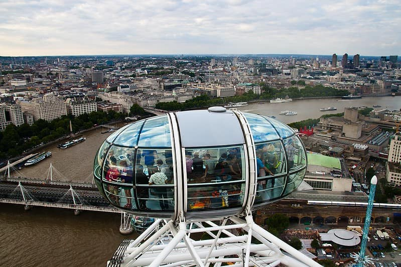 The pods on the London Eye with a view over the River Thames and the city.