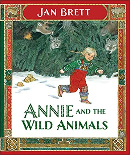 Cover of Annie And The Wild Animals: a young girl is smiling as she moves in the snow. In the background are some trees, with some animals hiding among them.