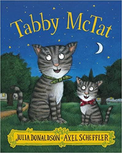 Cover of Tabby McTat: an adult striped cat and child striped cat sit on the grass in a park, happily looking at the night sky.