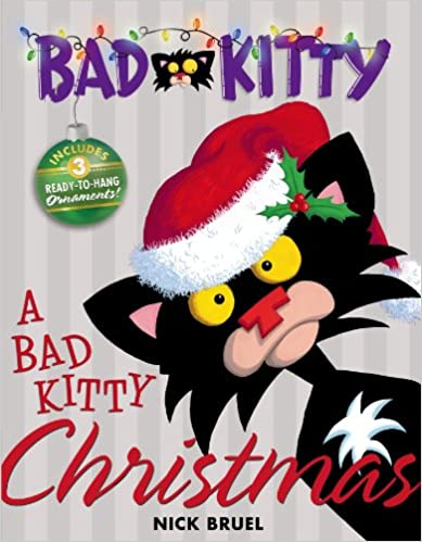 Cover of Bad Kitty: A black cat with yellow eyes is wearing a Christmas hat and is set against a pale background, looking at the viewer.