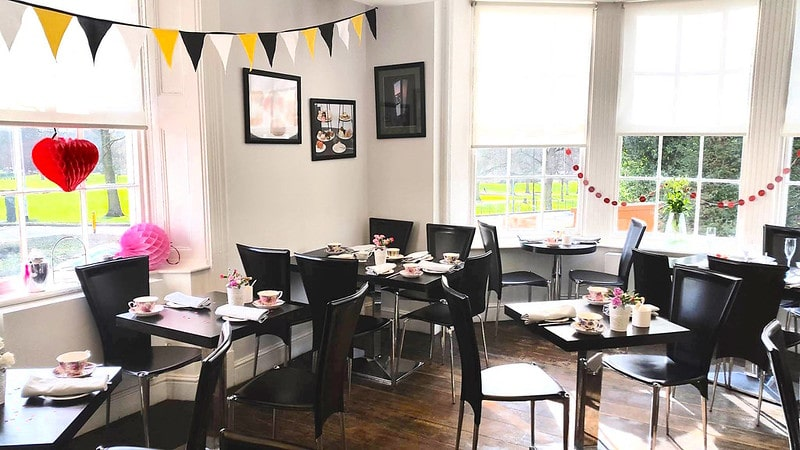 Afternoon tea at The Dining Room with bunting decorations.