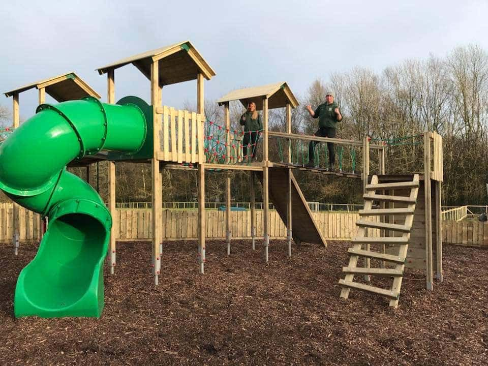 Children's playground with climbing frame and slide.