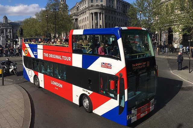 A tour bus from The Original Tour travelling through London.