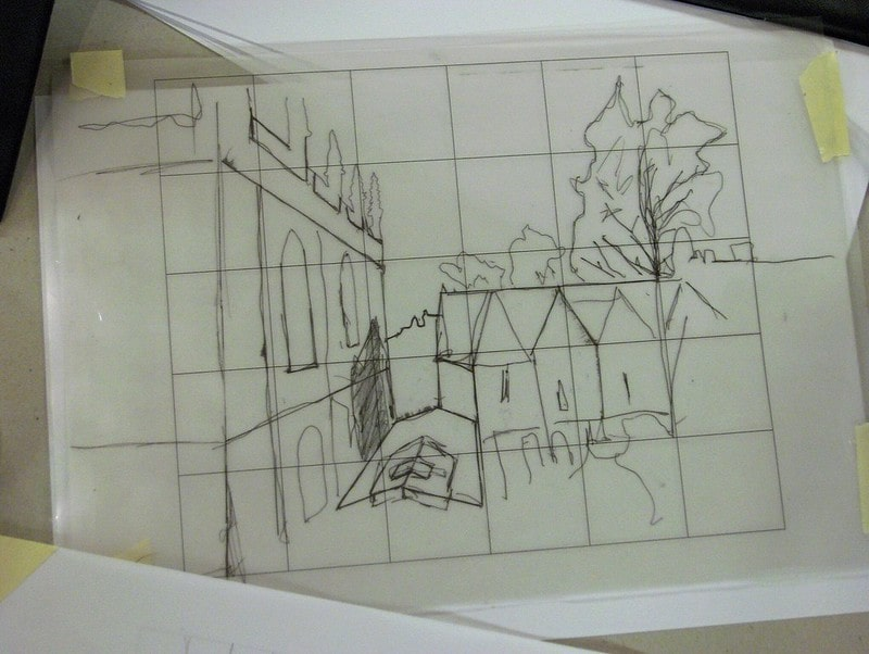 A sketch of old buildings and a tree.