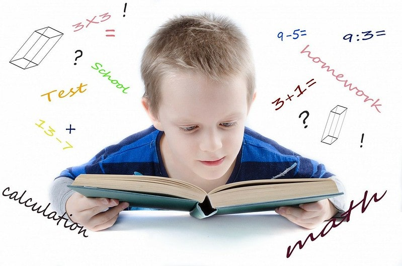 Boy looking at a boy with a mathematical word cloud around his head.