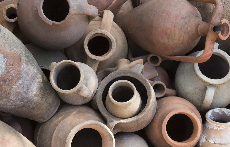 Ancient red and grey clay pots of different shapes and sizes