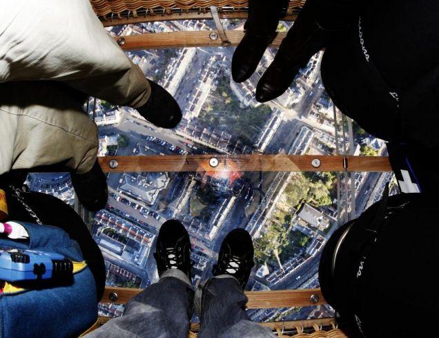 View looking down through a glass-bottomed hot air balloon.
