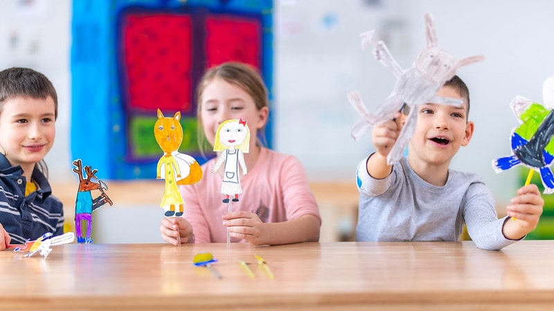Children Playing In Classroom With Their Own Rag Doll