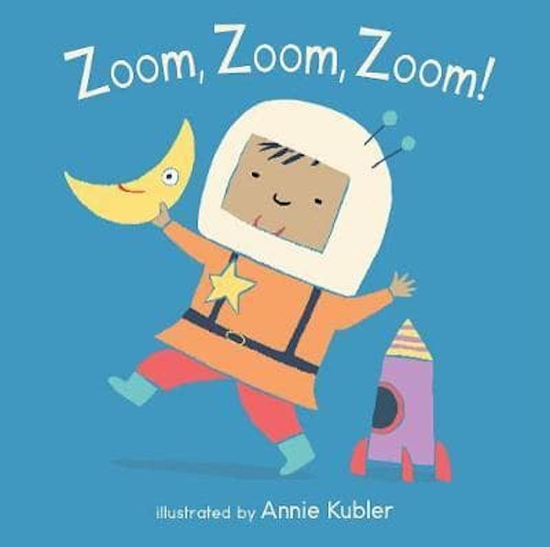 Cover of Zoom Zoom Zoom: against a blue background, a happy young child is wearing an astronaut helmet, holding a little toy moon in their hand.