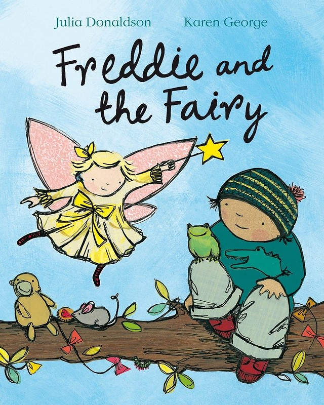 Cover of Freddie And The Fairy: Freddie is sat on a tree branch with some animals, and a fairy is beside him in the sky, pointing her magic wand.