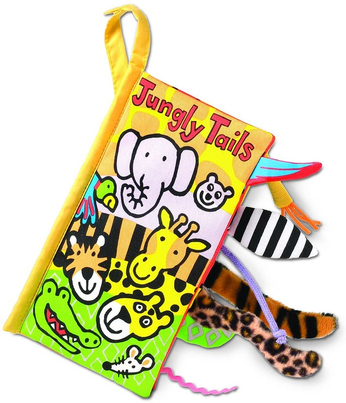 Cover of Jungly Tails: cartoons of jungle animals, with fabric animal tails sticking out of the book.