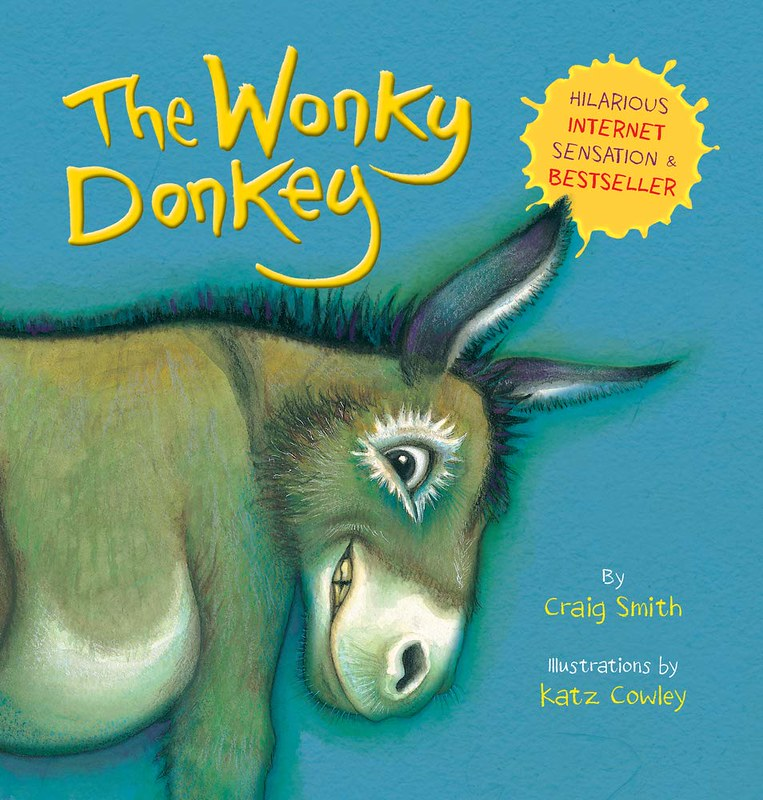 Cover of The Wonky Donkey: a brown donkey is smiling excitedly, against a blue background.