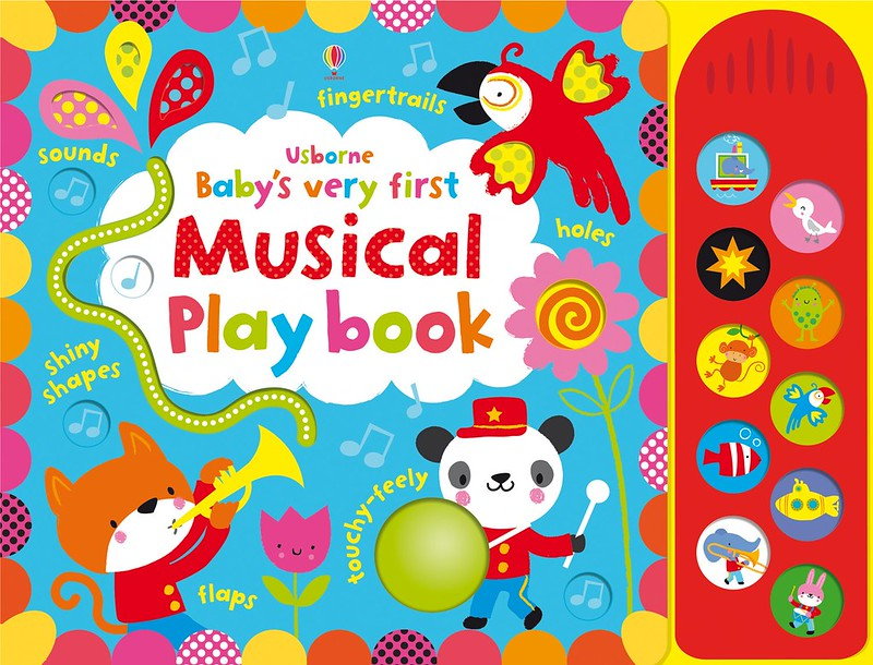 Cover of Baby's Very First Musical Playbook: two colourful animals are playing instruments and a parrot is singing. The background is blue, decorated with bright pattens and musical notes.
