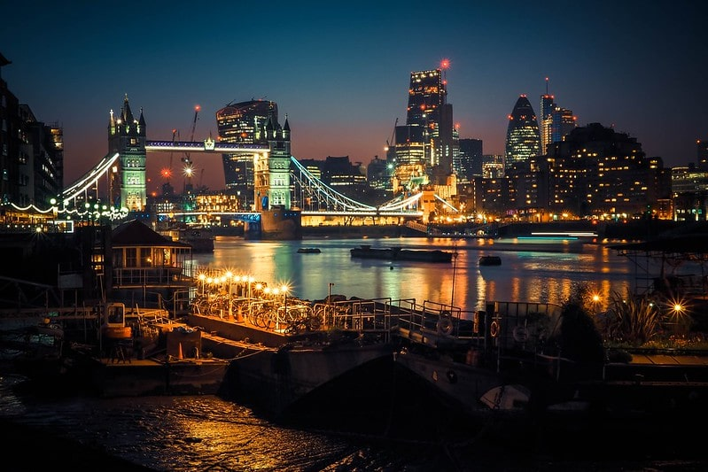 Tower Bridge lit up with the City of London in the background.