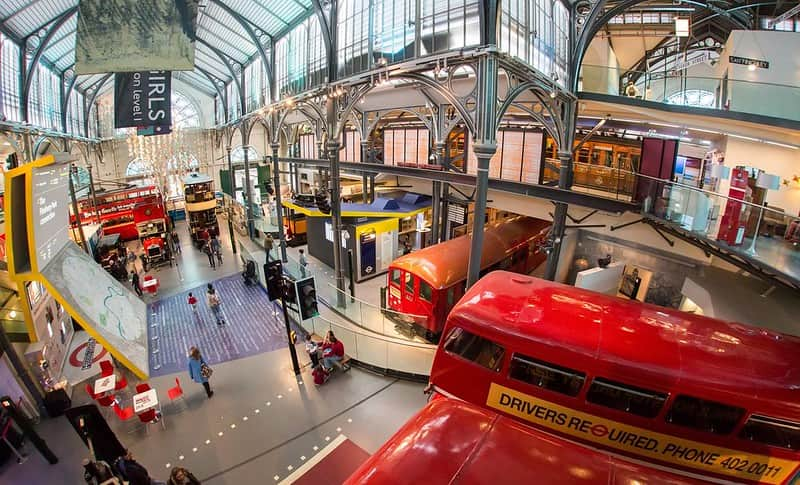 London Transport Museum main entrance, with buses and other vehicles all around.