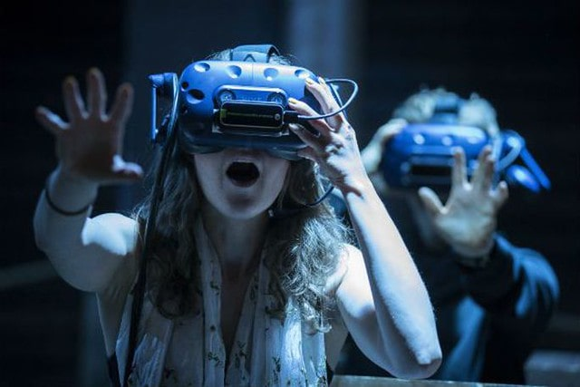 Audience members with VR headsets on the dreaded boat trip, part of the War of the Worlds Immersive Experience.