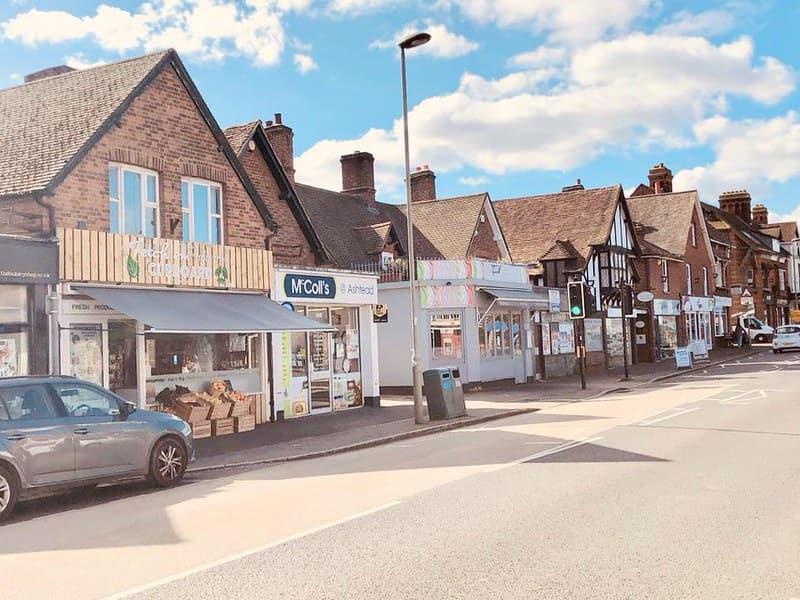 Shops on Ashtead high street, Surrey.