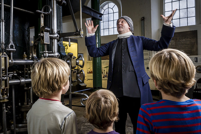 Kids at the London Museum of Water and Steam looking interested at a man