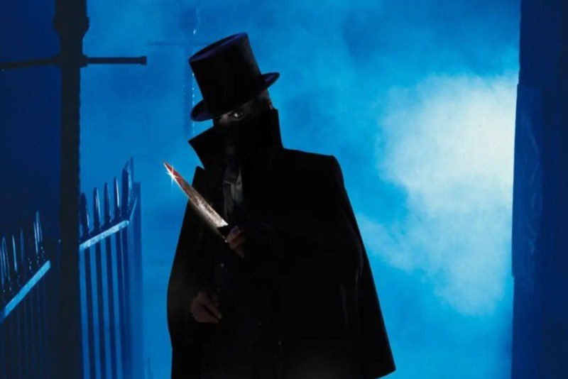 An illustration of Jack the Ripper, mostly in shadow except for his knife.