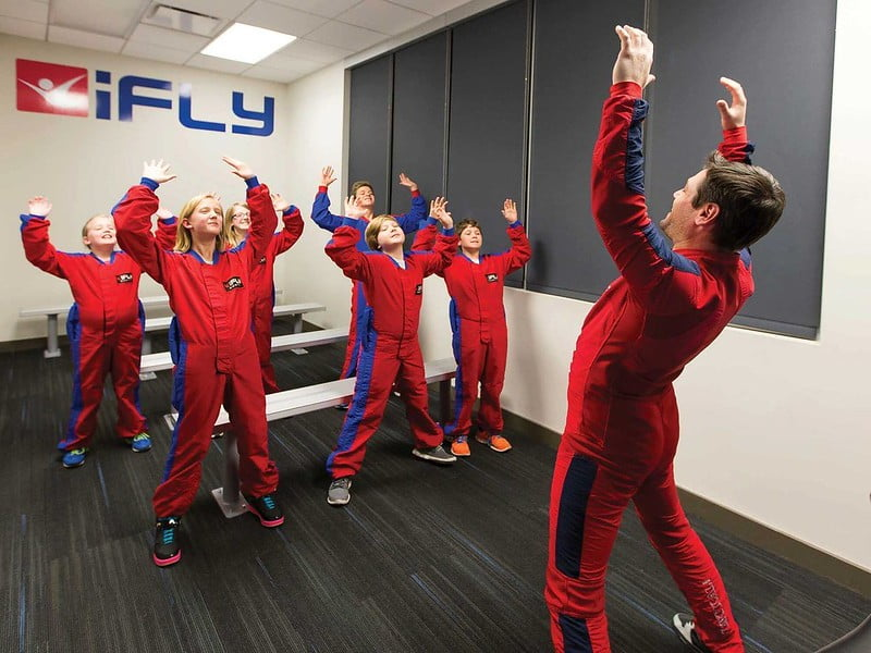 Group of kids having a briefing before their flying session at iFly.