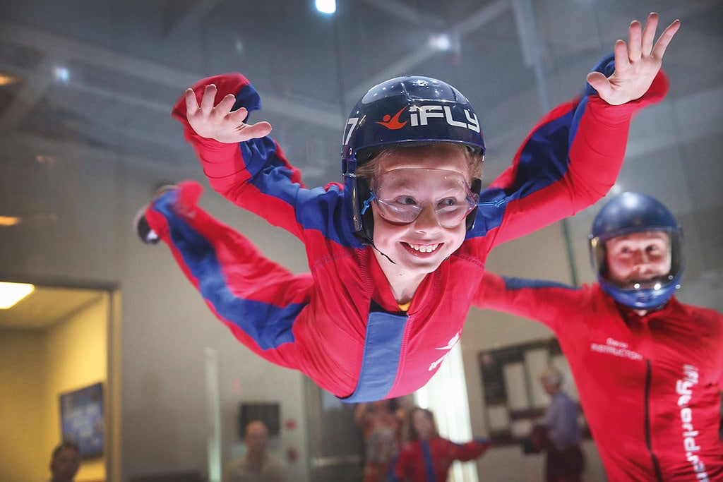Young girl doing indoor skydiving at iFly.