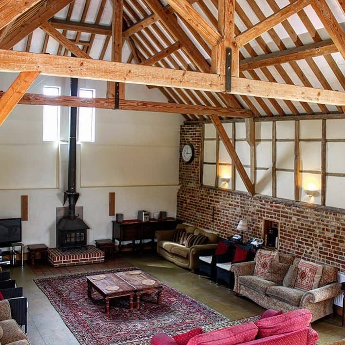 Beautiful living room with fireplace in a cottage at Burgate Manor Farm.