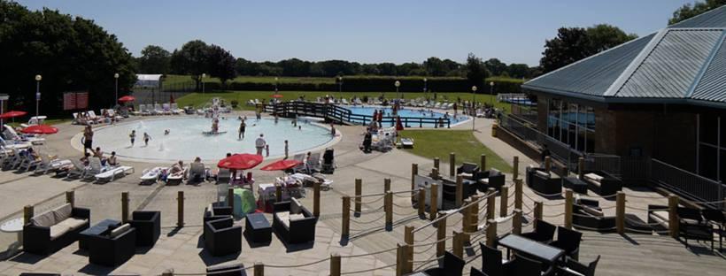 Families enjoying the swimming pool at Hoburne Bashley.