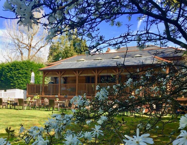 Spot in the Woods hotel with outdoor seating area and beautiful scenery.