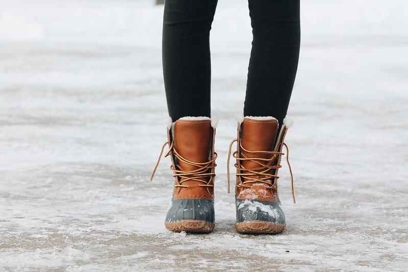 Close up of snow-boots on feet.